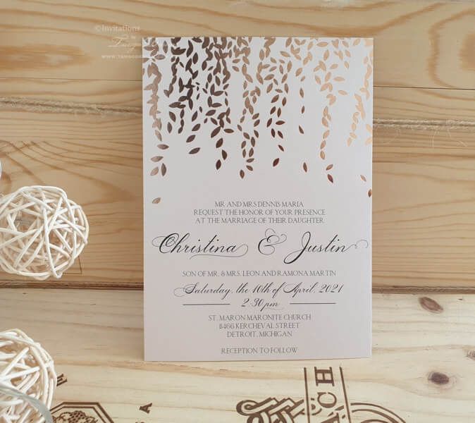 Rose gold wedding invitation with leaf design. Botanical, greenery or elegant rustic wedding theme.