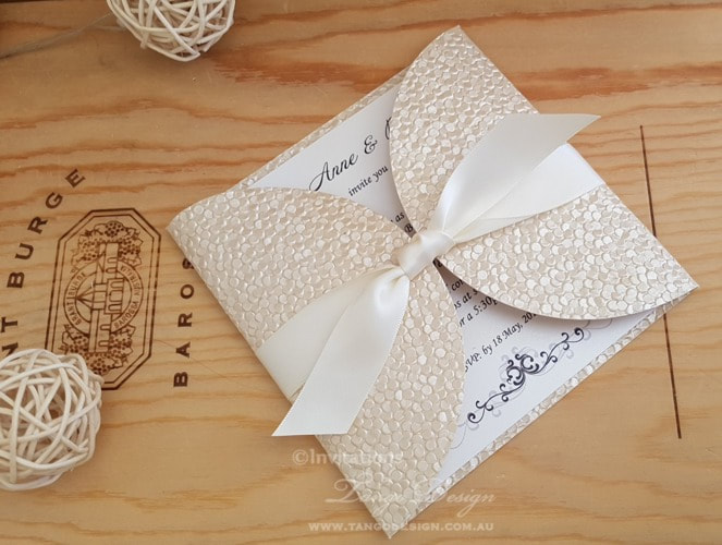 champagne pebble wedding invitation