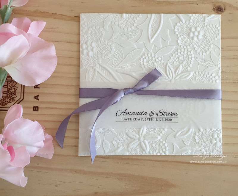 pocket wedding invitation set online australia with purple ribbon and floral embossed card