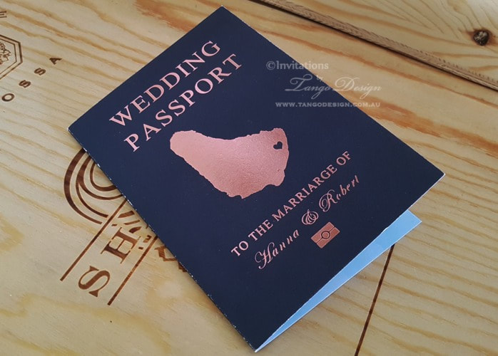 Blue Wedding invitation passport design printed in foil rosegold.