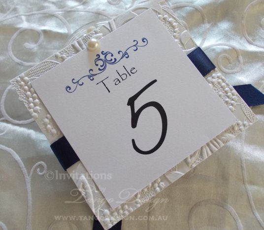 blue and white wedding table numbers and pearl